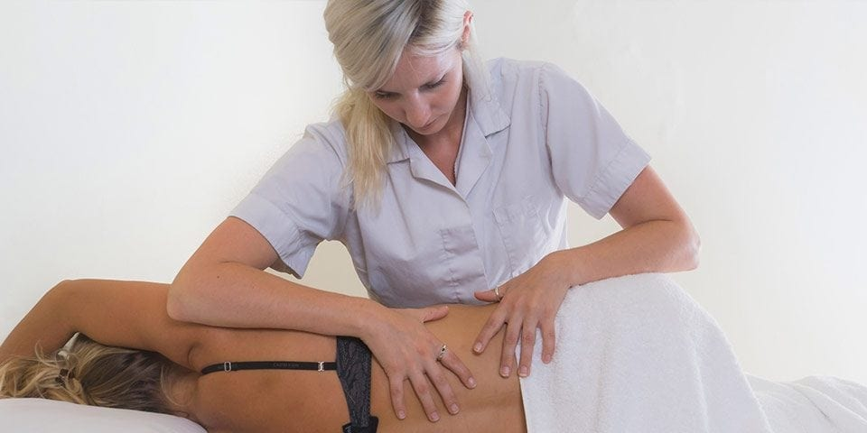 Osteopath treating a patient